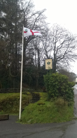 The Crown Hotel, Exford on Exmoor flying their custom flag by Red Dragon Flagmakers