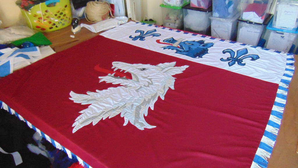 Woolf coat of arms banner by red dragon flagmakers
