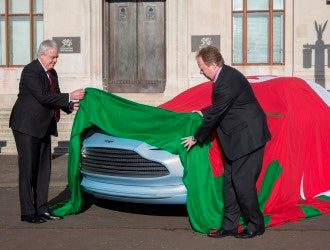 First Minister Carwyn Jones lifts the Red Dragon Flagmakers Welsh Flag from the new Aston Martin at the Welsh Assembly February 2016