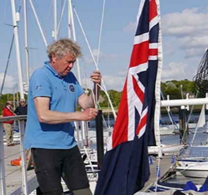 Red Dragon Flagmakers make the ensigns and courtesy flag for the Royal Southern Yacht Club, Prince Phillip's sailing club. This picture shows one of the blue ensigns being hoisted.