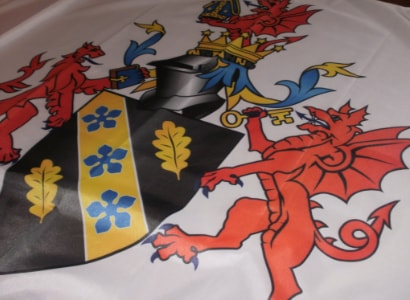 UWTSD coat of arms. UWTSD printed flag made by Red Dragon Flagmakers