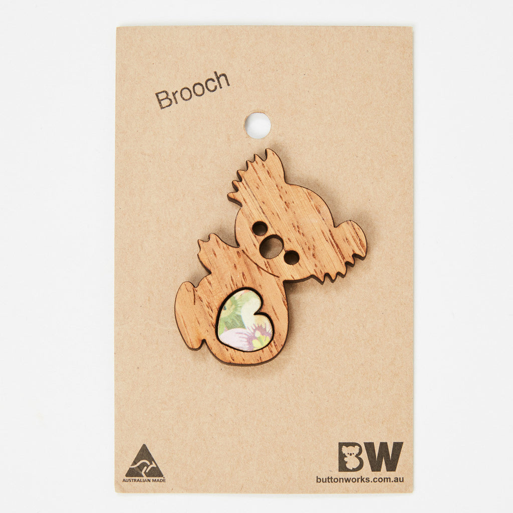 Animal brooch with heart insert