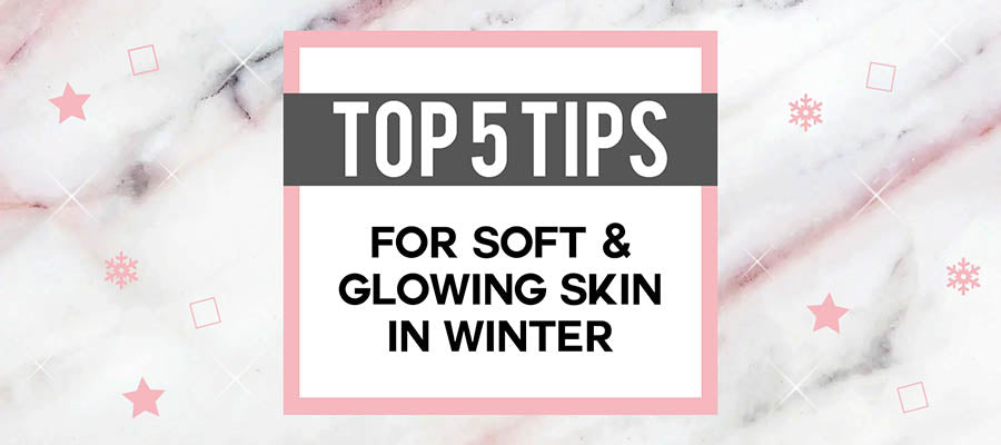 Top Tips for Soft Glowing Skin in Winter five pink stars sparkle marble flat lay
