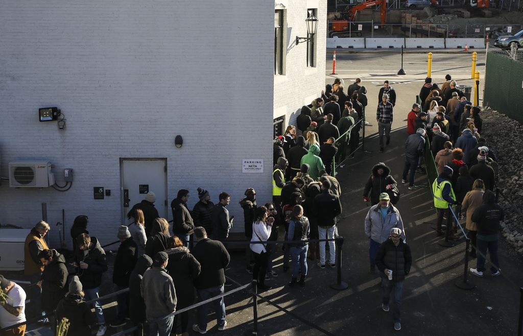 Line of people at a recreational marijuana dispensary in Boston Massachussets after legalization