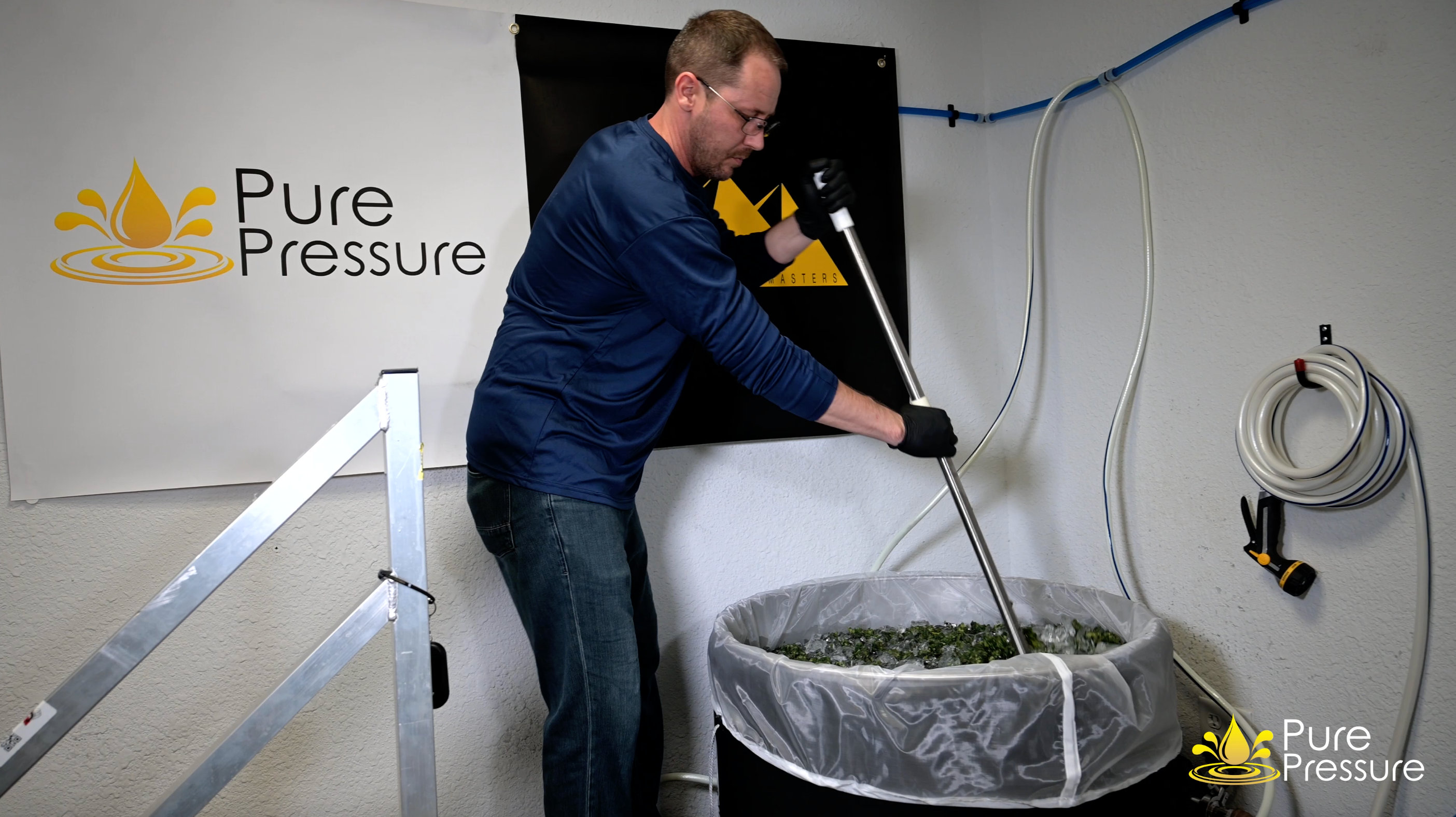 Eric Simpson hand paddling in a PurePressure Bruteless vessel at the Kush Masters facility.