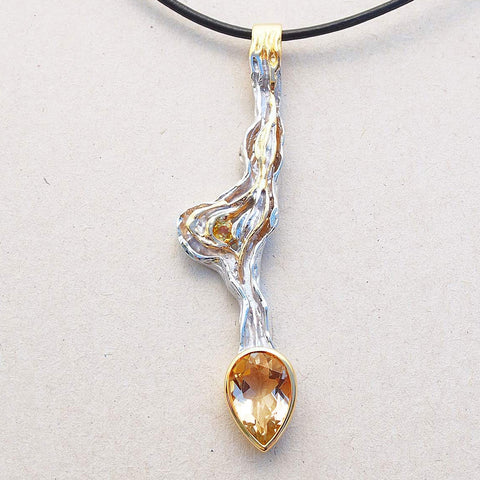 Long pendant with yellow stone
