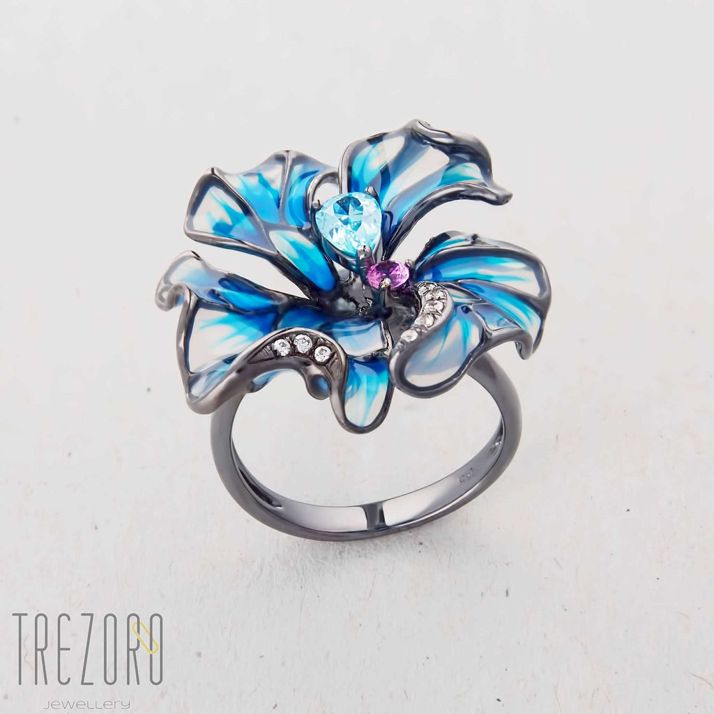 Flower Ring. Oxidised sterling silver with enamel and glass inserts and Cubic Zirconia.