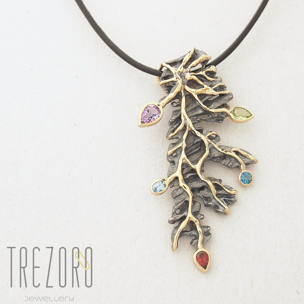Eternal Tree Designer Pendant. Oxidised Sterling Silver with Amethyst, Peridot, Garnet and Topaz. Rhodium plated with Gold accents. Trezoro Jewellery.