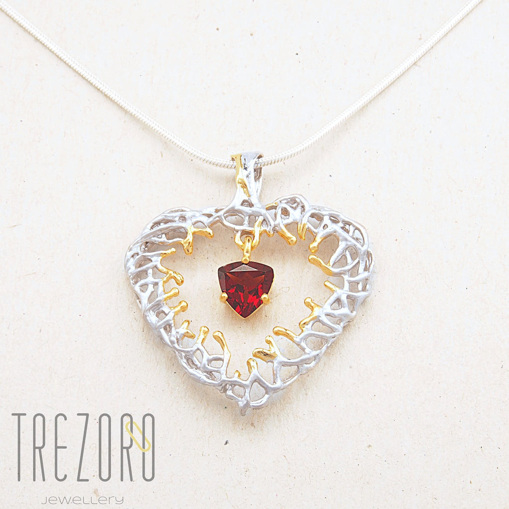 Deep in the Heart Designer Pendant. Sterling Silver with Garnet; Rhodium and Gold Plated. Juvite