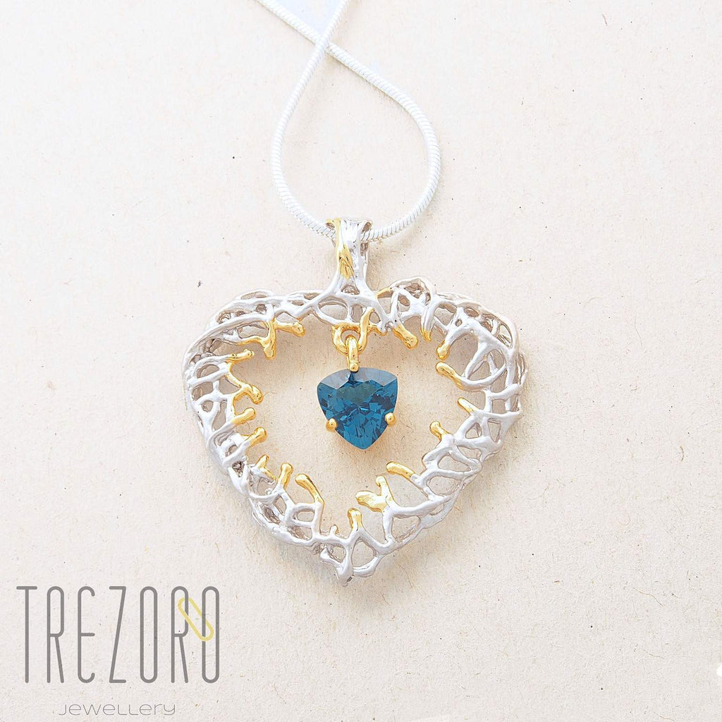 Deep in the Heart Designer Pendant. Sterling Silver with Topaz, Rhodium and Gold Plated. Juvite