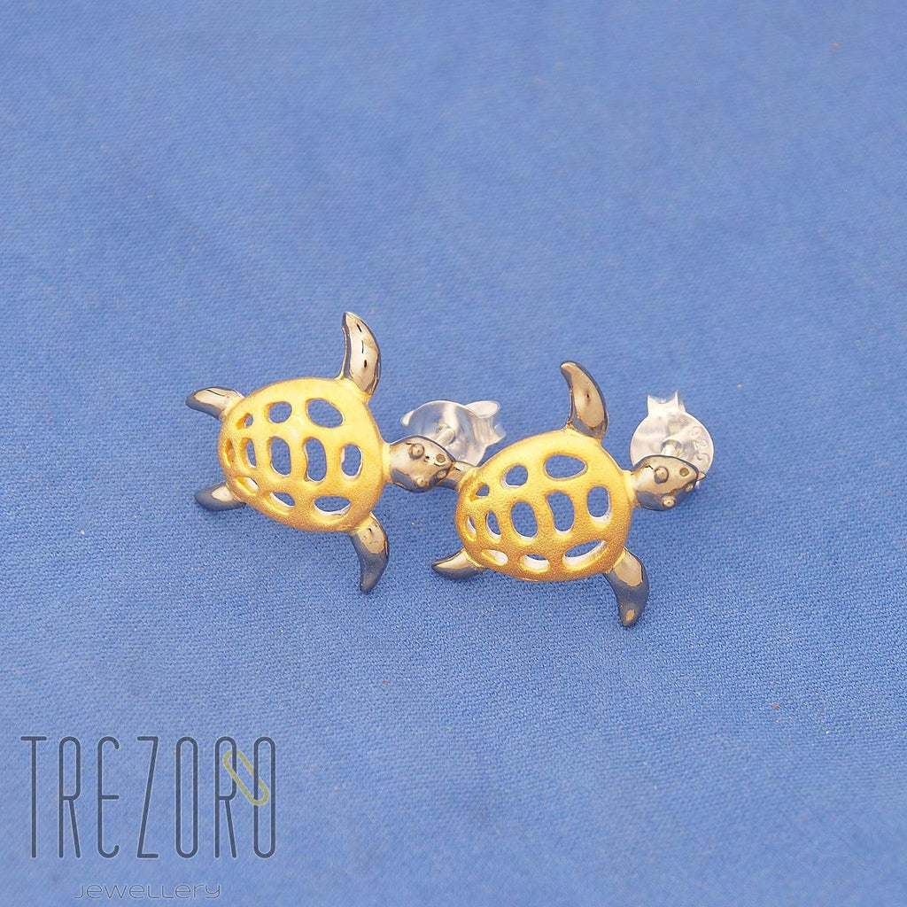 Turtles Sterling Silver Yellow Gold Black Rhodium Plated  Earrings on blue