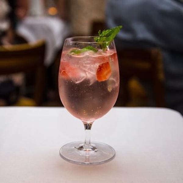 Rosa G&T cocktail – Boadicea Rosa Gin, elderflower tonic with fresh strawberries and mint sprig