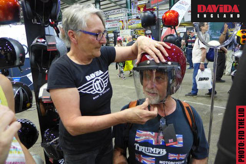 Sharon measures someone for a Davida lid at the Stafford Classic Bike Show in 2018