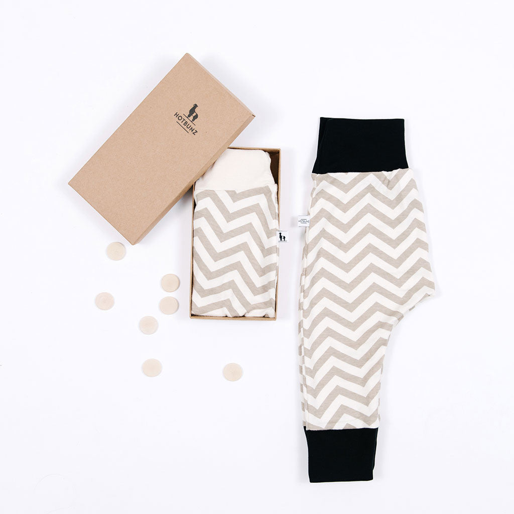 flat lay of  chevron baby pants gift set