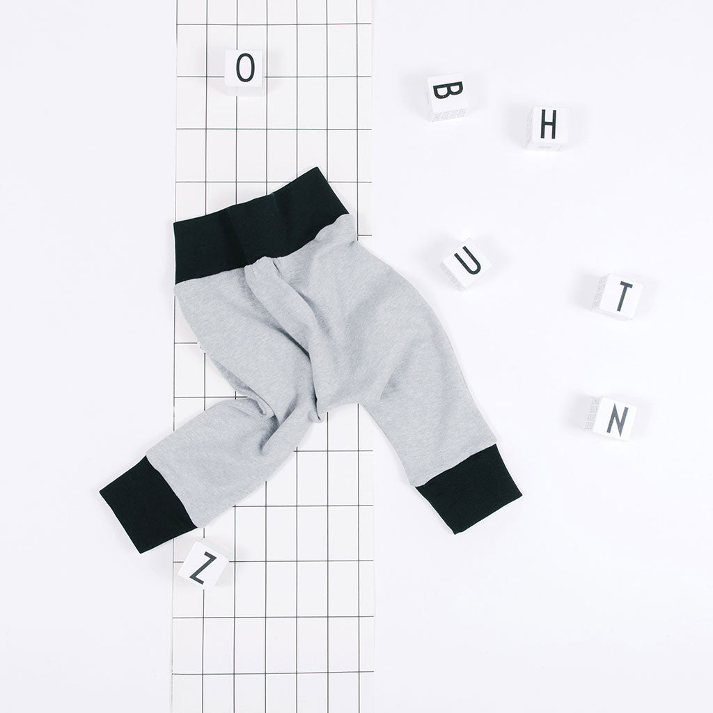 flat lay of classic grey organic baby pants