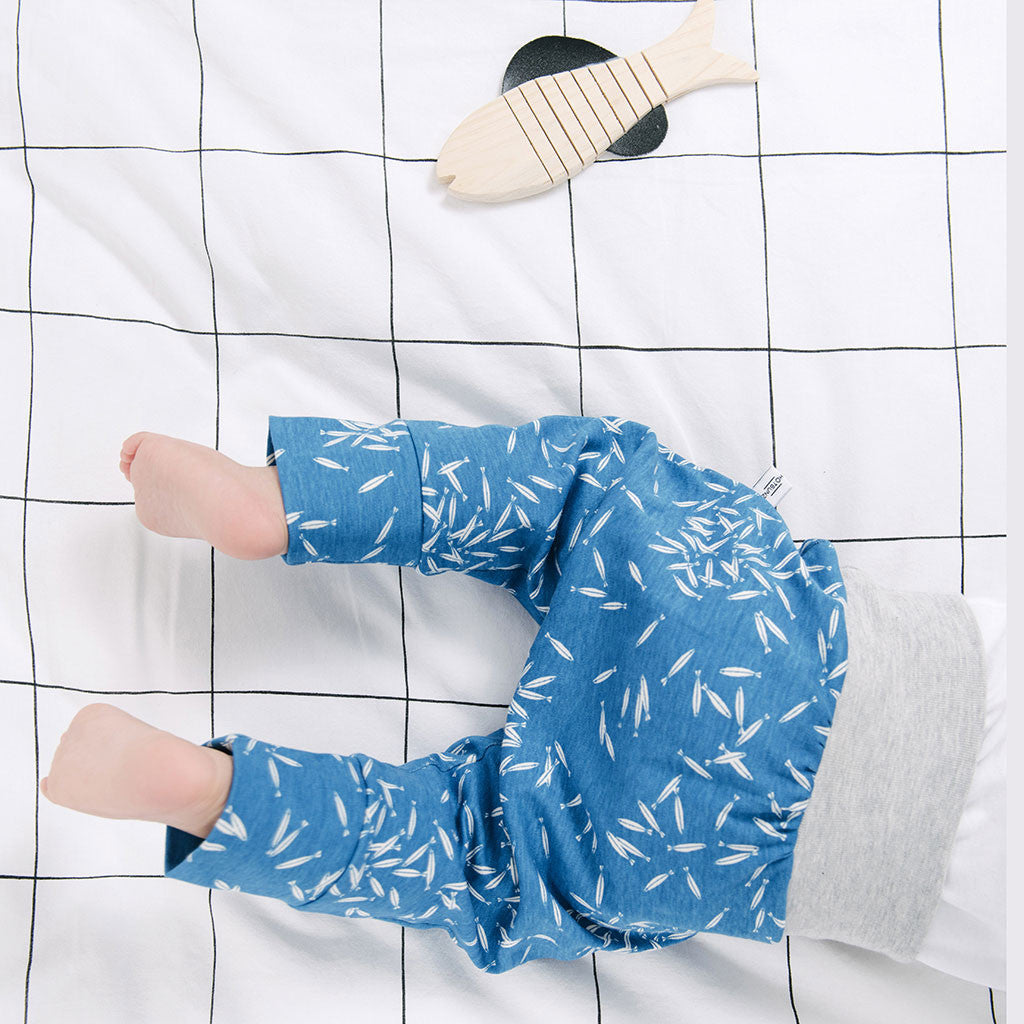 baby legs in blue pants with fish prints