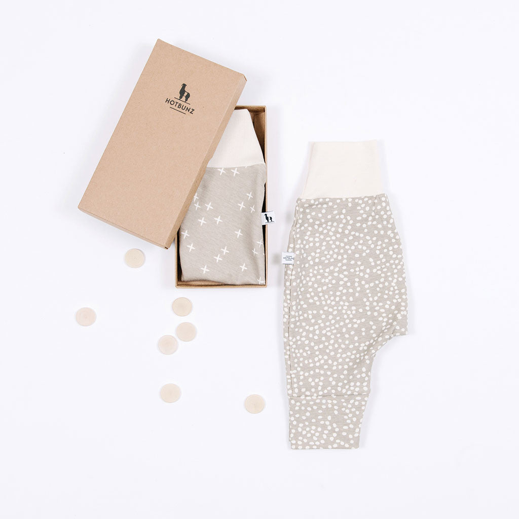 flat lay of sandbox baby pants gift set