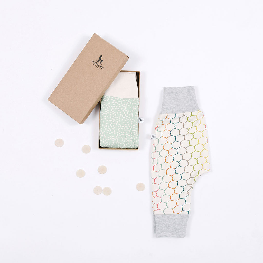 flatlay of baby pants gift set