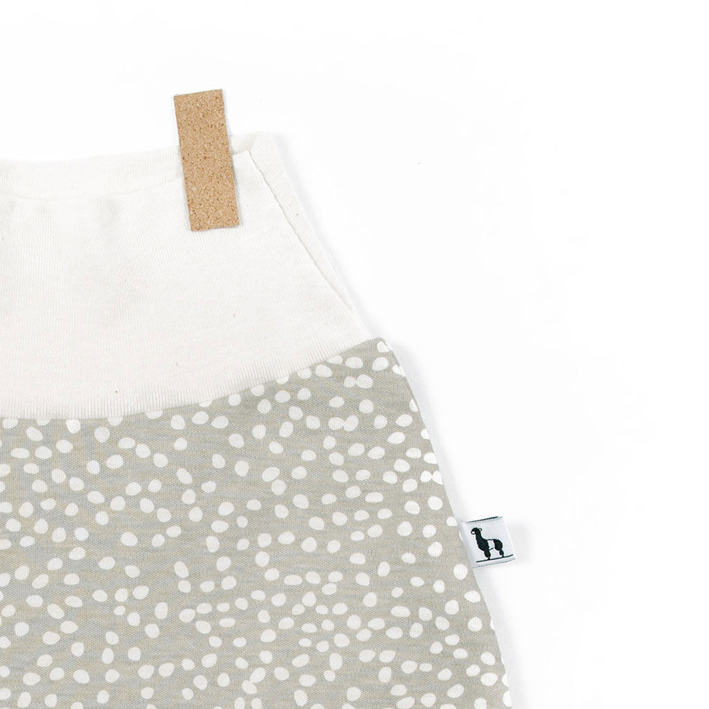 close-up of sandbox baby pants with small white dots