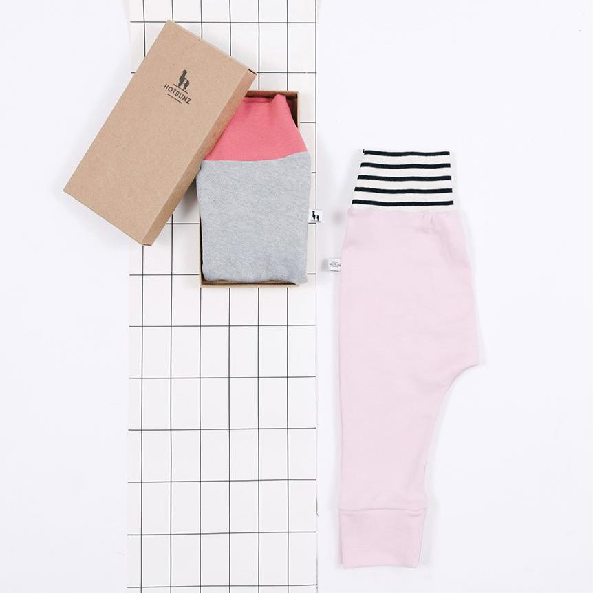 flatlay of pink baby pants gift set
