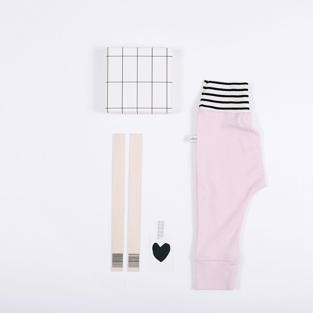 flat lay of pink baby pants