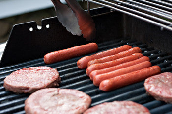 Burgers and hot dogs on grill