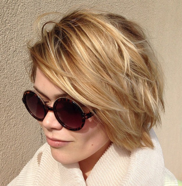woman with sunglasses, thick short blonde hair