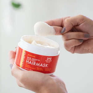 Woman using two fingertips to scoop a dollop of Premium Hair Growth Support Restorative Mask with Baicapil, Procapil, and Coconut oil
