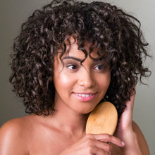 Load image into Gallery viewer, African American woman brushing her hair while smiling