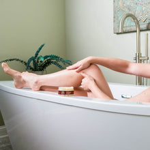 Load image into Gallery viewer, Woman rubbing Organic Lavender Sugar Body Scrub with Coconut on her calf in the bathtub