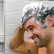 Load image into Gallery viewer, Man with full lather of Men's Hair Growth Strength and Support Shampoo