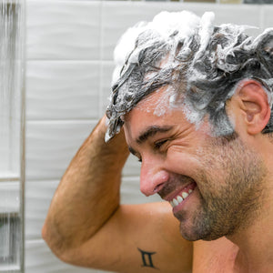 Man with full lather of Men's Hair Growth Strength and Support Shampoo