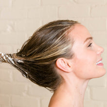 Load image into Gallery viewer, Woman applied Premium Hair Growth Support Restorative Mask with Baicapil, Procapil, and Coconut oil to the bottom of her hair in the shower