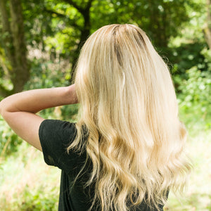 Woman showing her Beautiful Thick Blonde hair with wave on the bottom