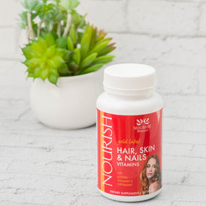 Bottle of Nourish gold label Hair, Skin, and Nails Multi Vitamin with Biotin, Vitamin C, Optimsm