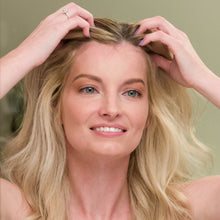 Load image into Gallery viewer, Woman applying Nourish Burst Hair Growth Accelerating Serum onto front head of blonde hair with her fingertips