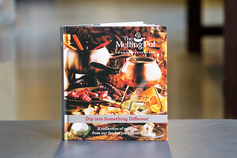 The Melting Pot Cookbook on Table
