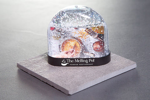 Snow Globe on Table with Inserted $75 Gift Card