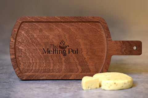 The Melting Pot Cheese Board on Table