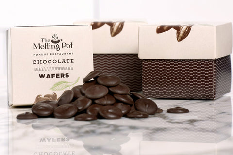 3 Boxes of Dark Chocolate Wafers on Table