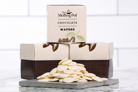 3 Boxes of White Chocolate Wafers on Table