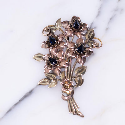Vintage 1940s Floral Bouquet Brooch Sterling Silver and Rose Gold Filled with Sapphire Blue Crystals by Vintage Meet Modern  - Vintage Meet Modern Vintage Jewelry - Chicago, Illinois - #oldhollywoodglamour #vintagemeetmodern #designervintage #jewelrybox #antiquejewelry #vintagejewelry