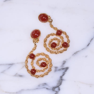 Vintage Avon Gold Scroll Statement Earrings with Carnelian Lucite Cabochons by Avon - Vintage Meet Modern Vintage Jewelry - Chicago, Illinois - #oldhollywoodglamour #vintagemeetmodern #designervintage #jewelrybox #antiquejewelry #vintagejewelry