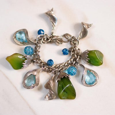 Vintage 1950s Mid Century Modern Blue and Green Lucite Charm Bracelet by Unsigned Beauty - Vintage Meet Modern Vintage Jewelry - Chicago, Illinois - #oldhollywoodglamour #vintagemeetmodern #designervintage #jewelrybox #antiquejewelry #vintagejewelry