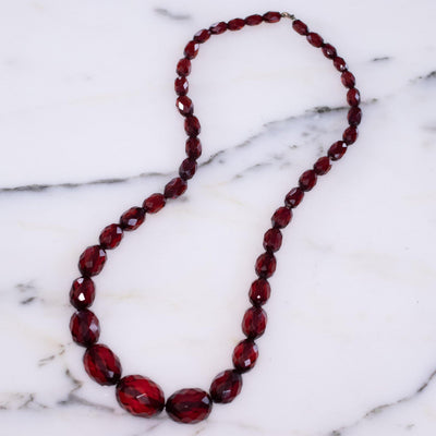 Vintage Cherry Juice Amber Bakelite Bead Necklace by Unsigned - Vintage Meet Modern Vintage Jewelry - Chicago, Illinois - #oldhollywoodglamour #vintagemeetmodern #designervintage #jewelrybox #antiquejewelry #vintagejewelry