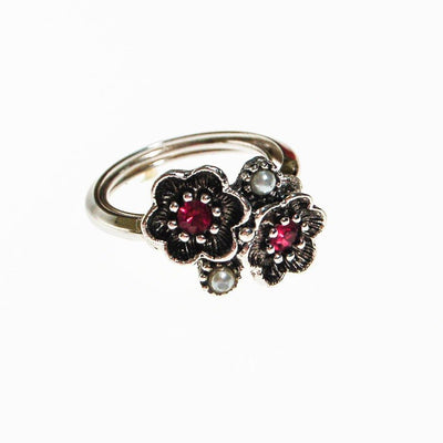 Avon Silver Flower Adjustable Ring with Pink Rhinestones and Faux Pearls, Silver Tone by unsigned - Vintage Meet Modern Vintage Jewelry - Chicago, Illinois - #oldhollywoodglamour #vintagemeetmodern #designervintage #jewelrybox #antiquejewelry #vintagejewelry