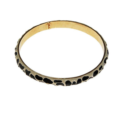 Black and White Zebra Bangle Bracelet by Kenneth Jay Lane by Kenneth Jay Lane - Vintage Meet Modern Vintage Jewelry - Chicago, Illinois - #oldhollywoodglamour #vintagemeetmodern #designervintage #jewelrybox #antiquejewelry #vintagejewelry