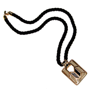 Diane von Furstenberg Cream and Black Pendant Necklace, Statement Necklace, Long Black Cord by Diane Von Furstenberg - Vintage Meet Modern Vintage Jewelry - Chicago, Illinois - #oldhollywoodglamour #vintagemeetmodern #designervintage #jewelrybox #antiquejewelry #vintagejewelry