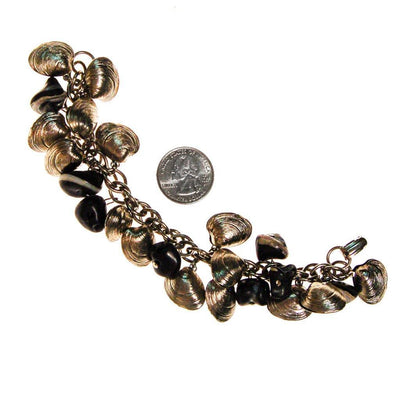 Silver Shell and Black Bead Loaded Charm Bracelet by 1960s - Vintage Meet Modern Vintage Jewelry - Chicago, Illinois - #oldhollywoodglamour #vintagemeetmodern #designervintage #jewelrybox #antiquejewelry #vintagejewelry