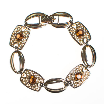 Sarah Coventry Amber Topaz Crystal and Filigree Link Panel Bracelet by Sarah Coventry - Vintage Meet Modern Vintage Jewelry - Chicago, Illinois - #oldhollywoodglamour #vintagemeetmodern #designervintage #jewelrybox #antiquejewelry #vintagejewelry